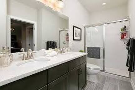 Custom sink cabinets inside of a full bathroom in Stamford, Connecticut