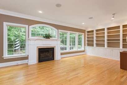 Custom built in bookshelves inside of a living room. The house is in Stamford, CT